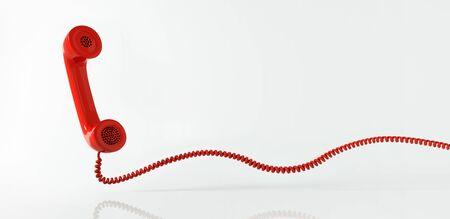 Rotes Telefon mit Spiralkabel - Service-Hotline