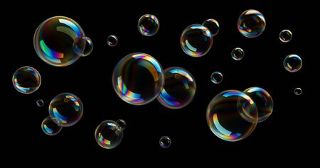 Soap bubbles in front of black background