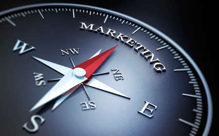 Black Compass with silver and red needle pointing at the word marketing