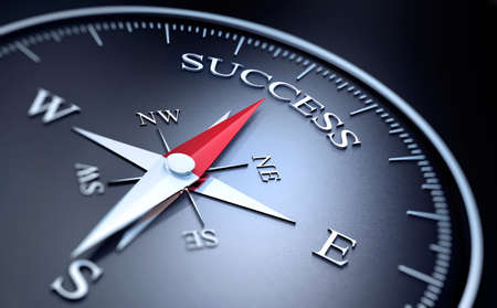 Black Compass with silver and red needle pointing at the word success