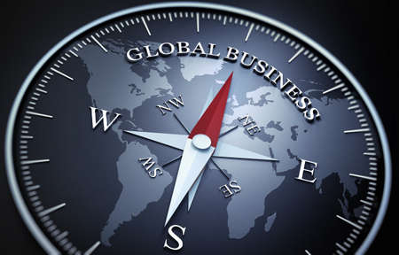 Black Compass with silver and red needle pointing at the word global business 免版税图像