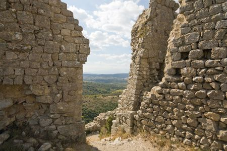 impregnable: View through the ruins of chateau aquilar, one of the cathar-castles in the languedoc, in the champaign of the languedoc