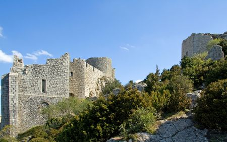 impregnable: The former patio of Chateau Peyrepertuse the biggest of the Cathar Castles in the Languedoc built on a mountain ridge Stock Photo