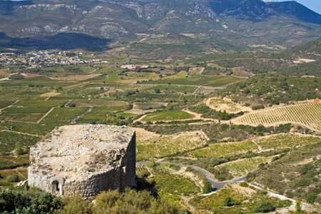impregnable: panoramic view from Chateau Aguilar, south france, in the champaign of the Languedoc. In the foreground the ruins of the old chapel
