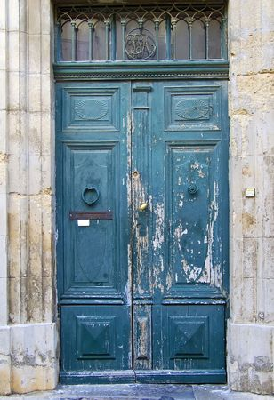 An old blue wooden door in the provence Stock Photo