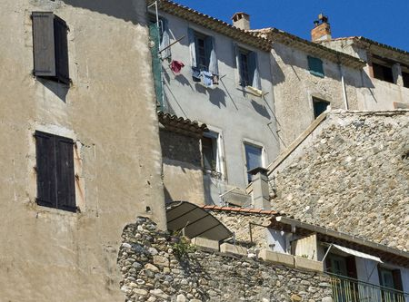 frontside of a few old houses in a little village in languedoc photo