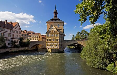 old town guildhall: Historic Town Hall, built on a bridge over the Regnitz river in Bamberg, Germany, Bavaria Stock Photo
