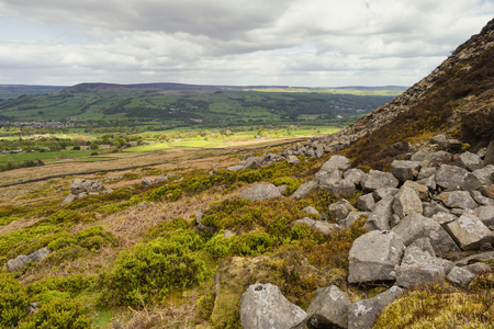 Ilkley Moor is part of Rombalds Moor, the moorland between Ilkley and Keighley in West Yorkshire, England. The moor, which rises to 402 m above sea level, is well known as the inspiration for the Yorkshire Stock Photo