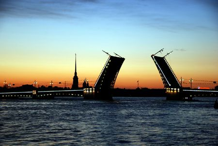 st petersburg: White nights. View of Neva river and raised Palace Bridge in St.Petersburg, Russia. Stock Photo