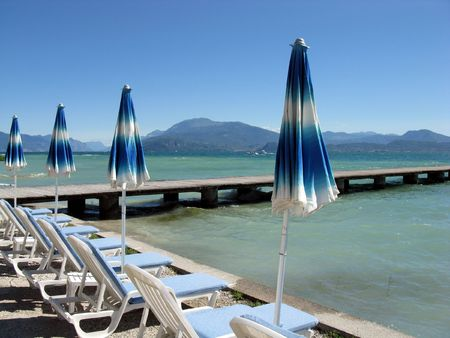 Sweet Loneliness.Lake Garda. The world-famous resort Sirmione. Italy. Stock Photo - 5152204