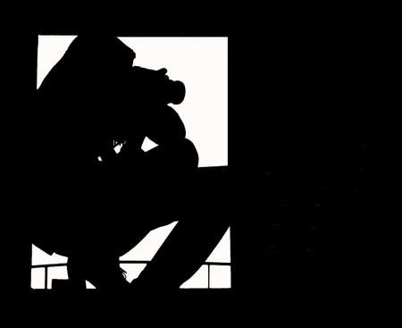 A silhouette of the professional girl-photographer taking pictures from the attic window photo