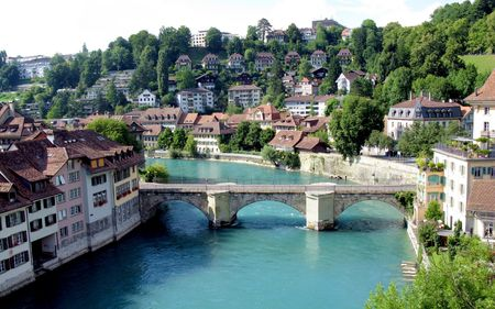 Medieval houses lining the banks of the Aare river in Bern (Unesco Heritage) , the capital of Switzerland. Stock Photo