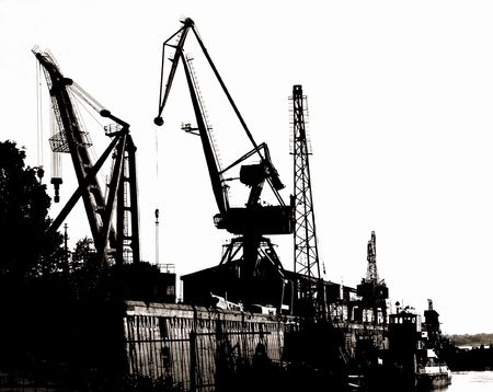 Silhouettes of Portal Cranes in a Harbor
