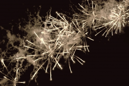 Multiple fireworks on black sky background