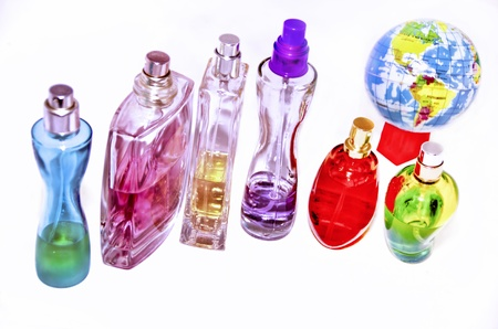 Multicolored perfumes in bottles of different shapes Stock Photo