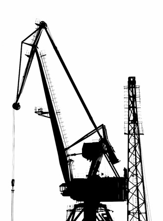 A Sulhouette of a Portal Crane in a Harbor