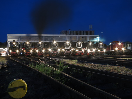 locomotives: Steam locomotives at night Before their roundhouse