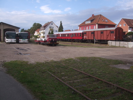 Railcar, a trolley and some buses at the train station