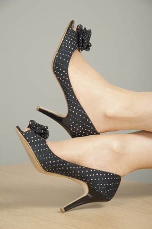 Woman with high heel shoes on desk photo