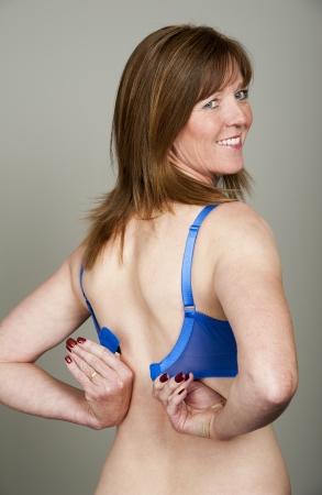 brassiere: Woman fastening her bra Stock Photo