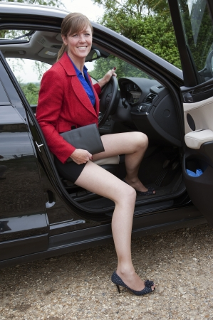 Female driver getting out of car