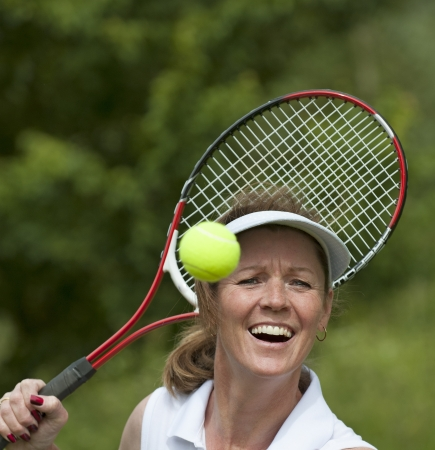 Female tennis player with racquet and ball photo