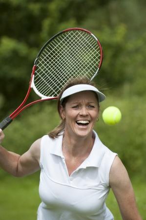Woman playing tennis Stock Photo