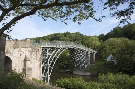 Historic Iron Bridge spans River Severn at Ironbridge in Shropshire England UK Stock Photo