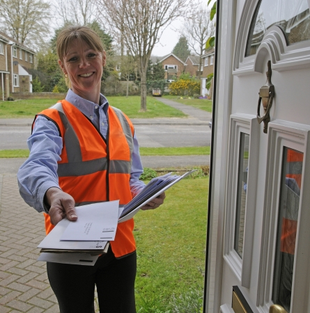 royal mail postwoman delivering mail to a customer