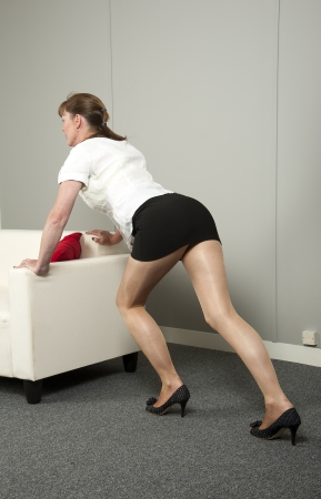 furniture: Woman moving office furniture
