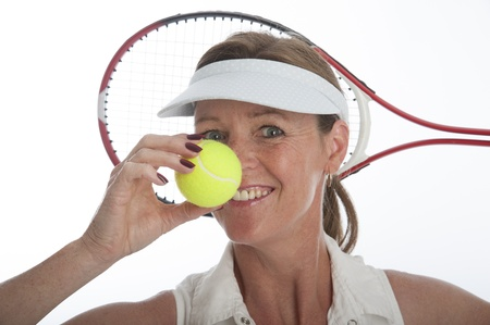 Female tennis player holding tennis ball Stock Photo - 21000186
