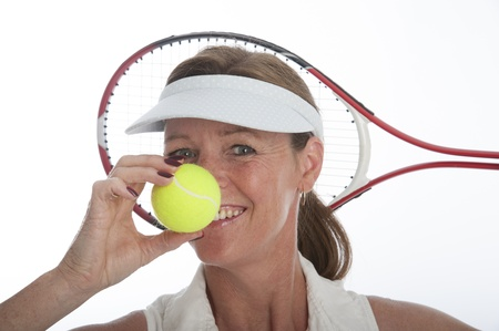 Female tennis player holding tennis ball Stock Photo - 21000187