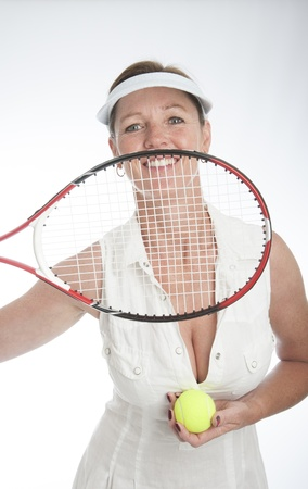 Female tennis player holding racquet Stock Photo