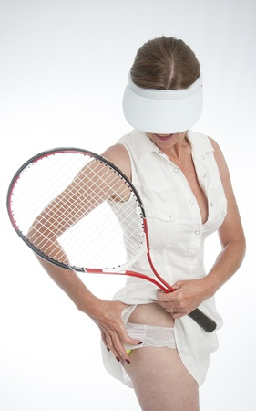 Female tennis player tucking the ball into her panties Stock Photo