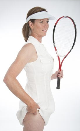 Female tennis player tucking the ball into her panties Stock Photo - 21000200