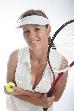 Portrait of a female tennis player holding her racquet and ball photo