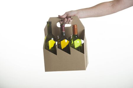 alcohol cardboard: Wine bottle carrier made from recycled cardboard