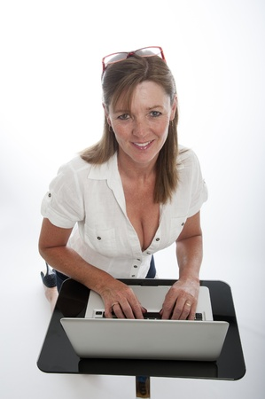 fuller figure: Woman working on a laptop computer Stock Photo