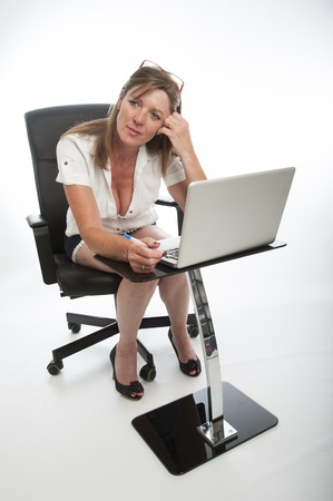 fuller figure: Female office worker using computer Stock Photo