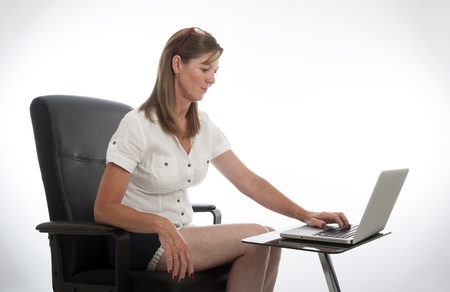 secretarial: Female office worker and computer