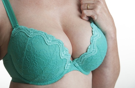 fuller figure: Woman wearing a green bra Stock Photo