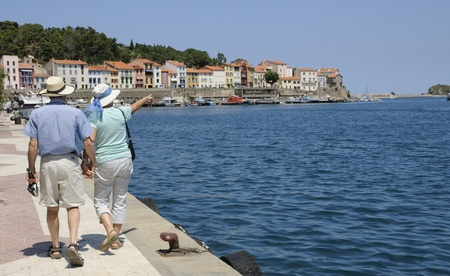 port vendres: Couple walking at Port Vendres southern France  Stock Photo