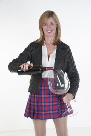 Woman pouring a very large glass of red wine photo