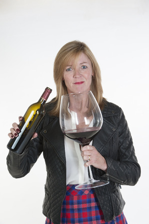 Woman with a bottle and a large glass of red wine