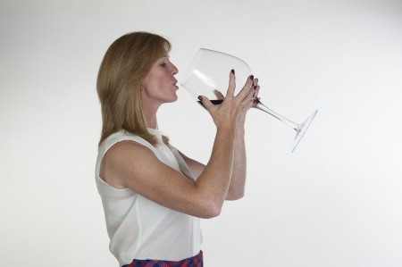 Woman with a very large glass of red wine Imagens