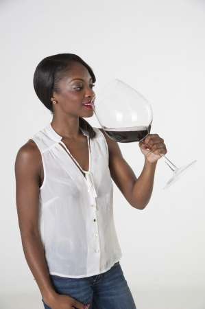 oversize: Woman holding very large glass of red wine