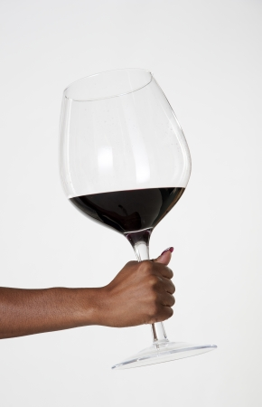 Woman holding very large glass of red wine Stock Photo - 22351275
