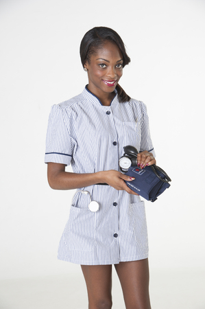 Nurse holding blood pressure monitor photo