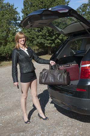 motorist: Female motorist loading her car Stock Photo