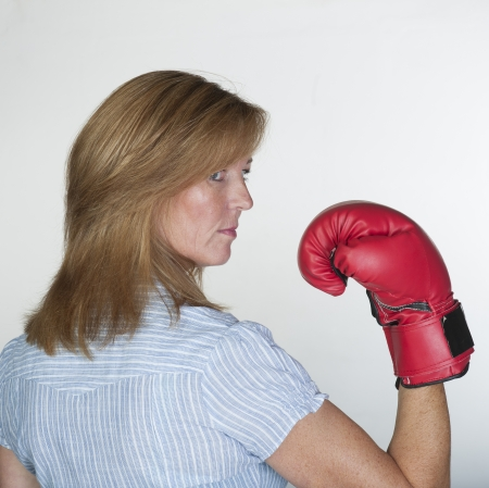 Woman wearing a red boxing glove photo